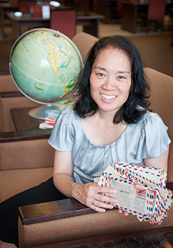 Professor Melody Miyamoto Walters holds letters written by her grandparents in Hawaii during the early days of World War II.