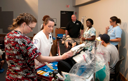 Collin College nursing students ran a simulated code situation for Nurse Campers to learn about what nurses do in emergency situations Aug. 3 at the Central Park Campus in McKinney.