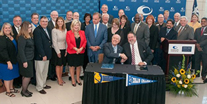 (Seated L-R) Dr. Ray Keck, interim president & CEO of Texas A&M University–Commerce and Dr. Neil Matkin, district president of Collin College, signed an agreement bringing university classes to the Collin College Preston Ridge Campus in Frisco on Wed., Oct. 12, while the Chancellor of the Texas A&M University System John Sharp and other university and college officials gathered in support.