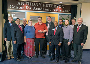 (Left to right) Shep Stahel, Collin College Foundation board of directors; Dr. Raj Menon, Collin College board of trustees and Foundation board of directors; Milton Buschbom, treasurer, Collin College Foundation board of directors; Glenna Peterson, Anthony Peterson's spouse; Anthony Peterson, benefactor; Dr. Neil Matkin, Collin College district president; Fred Moses, Collin College board of trustees and Foundation board; Bill Cox, immediate past chair, Collin College Foundation board of directors; Matt Foster, Collin College Foundation board of directors; Matt Ford, Collin College Foundation board of directors and Dr. Bob Collins, chair, Collin College board of trustees unveil the new Anthony Peterson Center for Academic Assistance at the Collin College Spring Creek Campus. Anthony's $150,000 gift will provide two additional centers bearing his name at the college's campuses in Frisco and McKinney.