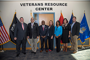 (Pictured from left): Collin College District President Dr. Neil Matkin and speakers William Dwiggins, Colonel, USMC RET., Veterans Education Coordinator, Texas Veterans Commission and Robert Scott, assistant vice president, Customer Care Center, State Farm join State Farm representatives Stacey Albin, Princella Young, Mackenzie Long and Darren Allred and celebrate the Collin College Veterans Resource Centers.