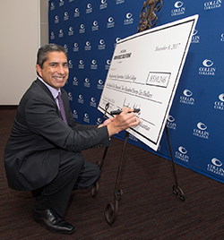 Texas Workforce Commission Chairman and Commissioner Representing the Public, Andres Alcantar signs the ceremonial check presented at Collin College on Nov. 8.