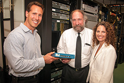 Matthew Stauble of Palo Alto Networks presented a gift of firewall units to Dave Galley, director of the engineering tech program, and Amy Evans, executive director of the Collin College Foundation